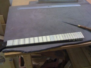 Neck ready for fret levelling